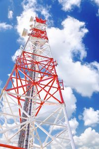 Broadcast tower, blue sky, and clouds
