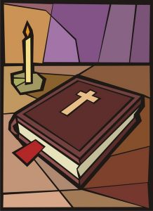 Bible with candle